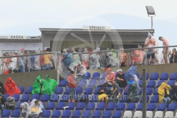 World © Octane Photographic Ltd. Fans in the grandstands during the thunderstorm. Friday 1st July 2016, F1 Austrian GP Practice 2, Red Bull Ring, Spielberg, Austria. Digital Ref : 1600CB1D2500