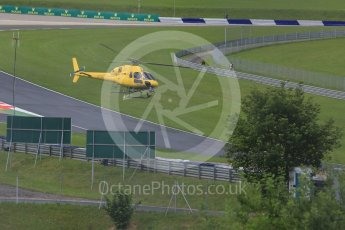 World © Octane Photographic Ltd. The TV helicopter making low passes. Friday 1st July 2016, F1 Austrian GP Practice 2, Red Bull Ring, Spielberg, Austria. Digital Ref : 1600CB5D3161