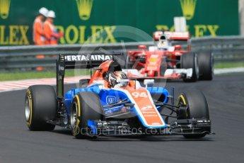 World © Octane Photographic Ltd. Manor Racing MRT05 - Pascal Wehrlein and Scuderia Ferrari SF16-H – Sebastian Vettel. Saturday 23rd July 2016, F1 Hungarian GP Practice 3, Hungaroring, Hungary. Digital Ref :1647CB1D7592