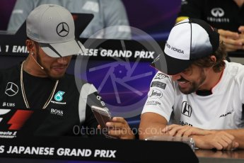 World © Octane Photographic Ltd. F1 Singapore GP FIA Driver Press Conference, Suzuka Circuit, Suzuka, Japan. Thursday 6th October 2016. Mercedes AMG Petronas – Lewis Hamilton and McLaren Honda - Fernando Alonso chat. Digital Ref : 1727LB1D3371