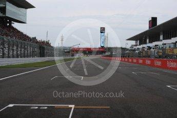 World © Octane Photographic Ltd. Empty starting grid and the run to turn 1. Sunday 9th October 2016, F1 Japanese GP, Suzuka Circuit, Suzuka, Japan. Digital Ref :1735LB1D6946