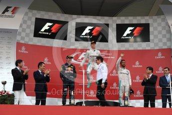 World © Octane Photographic Ltd. Mercedes AMG Petronas – Nico Rosberg (1st) Red Bull Racing – Max Verstappen (2nd) and Mercedes AMG Petronas – Lewis Hamilton (3rd). Sunday 9th October 2016, F1 Japanese GP - Podium. Suzuka Circuit, Suzuka, Japan. Digital Ref :1737LB1D8419