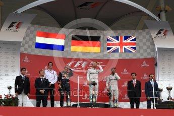 World © Octane Photographic Ltd. Mercedes AMG Petronas – Nico Rosberg (1st), Red Bull Racing – Max Verstappen (2nd) and Mercedes AMG Petronas – Lewis Hamilton (3rd). Sunday 9th October 2016, F1 Japanese GP - Podium. Suzuka Circuit, Suzuka, Japan. Digital Ref :1737LB1D8438