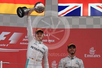World © Octane Photographic Ltd. Mercedes AMG Petronas – Nico Rosberg (1st) and Lewis Hamilton (3rd). Sunday 9th October 2016, F1 Japanese GP - Podium. Suzuka Circuit, Suzuka, Japan. Digital Ref :1737LB1D8506