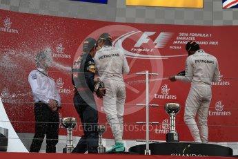 World © Octane Photographic Ltd. Mercedes AMG Petronas – Nico Rosberg (1st), Red Bull Racing – Max Verstappen (2nd) and Mercedes AMG Petronas – Lewis Hamilton (3rd). Sunday 9th October 2016, F1 Japanese GP - Podium. Suzuka Circuit, Suzuka, Japan. Digital Ref :1737LB1D8608