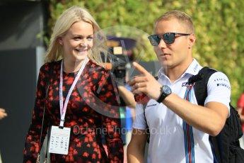 World © Octane Photographic Ltd. Williams Martini Racing – Valtteri Bottas and new wife Emilia Pikkarainen. Friday 16th September 2016, F1 Singapore GP Paddock, Marina Bay Circuit, Singapore. Digital Ref :1715CB1D5616