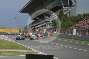 World © Octane Photographic Ltd. Mercedes AMG Petronas W07 Hybrid – Nico Rosberg and Lewis Hamilton lead the pack on the off the line. Sunday 15th May 2016, F1 Spanish GP Race, Circuit de Barcelona Catalunya, Spain. Digital Ref :