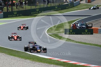 World © Octane Photographic Ltd. Scuderia Toro Rosso STR11 – Carlos Sainz leads the 2 Ferraris. Sunday 15th May 2016, F1 Spanish GP Race, Circuit de Barcelona Catalunya, Spain. Digital Ref :