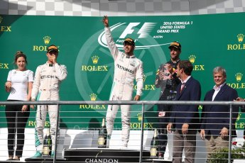 World © Octane Photographic Ltd. Mercedes AMG Petronas – Lewis Hamilton (1st) and Nico Rosberg (2nd) and Red Bull Racing – Daniel Ricciardo (3rd) with Victoria Vowels - Mercedes Partner Services Director. Sunday 23rd October 2016, F1 USA Grand Prix Podium, Austin, Texas – Circuit of the Americas (COTA). Digital Ref :1750LB1D4247