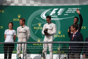 World © Octane Photographic Ltd. Mercedes AMG Petronas – Lewis Hamilton (1st) and Nico Rosberg (2nd) and Red Bull Racing – Daniel Ricciardo (3rd) with Victoria Vowels - Mercedes Partner Services Director. Sunday 23rd October 2016, F1 USA Grand Prix Podium, Austin, Texas – Circuit of the Americas (COTA). Digital Ref :1750LB1D4310