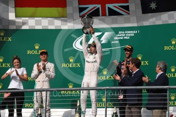 World © Octane Photographic Ltd. Mercedes AMG Petronas – Lewis Hamilton (1st) and Nico Rosberg (2nd) and Red Bull Racing – Daniel Ricciardo (3rd) with Victoria Vowels - Mercedes Partner Services Director. Sunday 23rd October 2016, F1 USA Grand Prix Podium, Austin, Texas – Circuit of the Americas (COTA). Digital Ref :1750LB1D4343