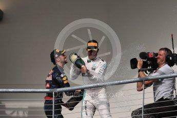 World © Octane Photographic Ltd. Mercedes AMG Petronas – Lewis Hamilton (1st) and Red Bull Racing – Daniel Ricciardo (3rd). Sunday 23rd October 2016, F1 USA Grand Prix Podium, Austin, Texas – Circuit of the Americas (COTA). Digital Ref :1750LB1D4451