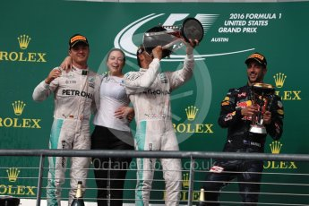 World © Octane Photographic Ltd. Mercedes AMG Petronas – Lewis Hamilton (1st) and Nico Rosberg (2nd) and Red Bull Racing – Daniel Ricciardo (3rd) with Victoria Vowels - Mercedes Partner Services Director. Sunday 23rd October 2016, F1 USA Grand Prix Podium, Austin, Texas – Circuit of the Americas (COTA). Digital Ref :1750LB1D4561