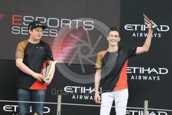 World © Octane Photographic Ltd. F1 eSports podium - Abu Dhabi, Yas Marina Circuit - 26 November 2017. Brendon Leigh and Sven Zurner.