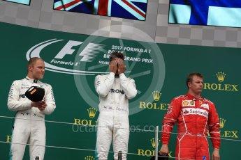 World © Octane Photographic Ltd. Formula 1 - British Grand Prix - Sunday - Race Podium. Lewis Hamilton and Valtteri Bottas - Mercedes AMG Petronas F1 W08 EQ Energy+ and Kimi Raikkonen - Scuderia Ferrari SF70H. Silverstone, UK. Sunday 16th July 2017. Digital Ref: 1893LB1D4772