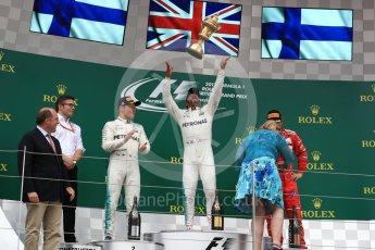 World © Octane Photographic Ltd. Formula 1 - British Grand Prix - Sunday - Race Podium. Lewis Hamilton and Valtteri Bottas - Mercedes AMG Petronas F1 W08 EQ Energy+ and Kimi Raikkonen - Scuderia Ferrari SF70H. Silverstone, UK. Sunday 16th July 2017. Digital Ref: 1893LB1D4837