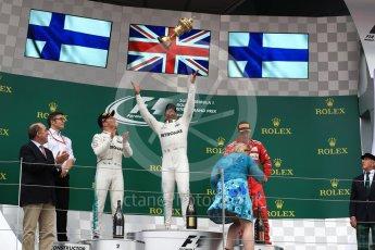 World © Octane Photographic Ltd. Formula 1 - British Grand Prix - Sunday - Race Podium. Lewis Hamilton and Valtteri Bottas - Mercedes AMG Petronas F1 W08 EQ Energy+ and Kimi Raikkonen - Scuderia Ferrari SF70H. Silverstone, UK. Sunday 16th July 2017. Digital Ref: 1893LB1D4841