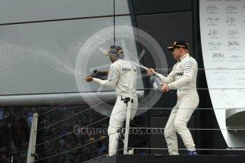 World © Octane Photographic Ltd. Formula 1 - British Grand Prix - Sunday - Race Podium. Lewis Hamilton and Valtteri Bottas Mercedes AMG Petronas F1 W08 EQ Energy+. Silverstone, UK. Sunday 16th July 2017. Digital Ref: 1893LB1D5010