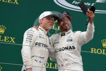World © Octane Photographic Ltd. Formula 1 - British Grand Prix - Sunday - Race Podium. Lewis Hamilton and Valtteri Bottas Mercedes AMG Petronas F1 W08 EQ Energy+. Silverstone, UK. Sunday 16th July 2017. Digital Ref: 1893LB1D5306