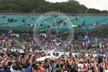 World © Octane Photographic Ltd. Formula 1 - British Grand Prix - Sunday - Race Podium. Lewis Hamilton - Mercedes AMG Petronas F1 W08 EQ Energy+ crowd surfs. Silverstone, UK. Sunday 16th July 2017. Digital Ref: 1893LB1D5496