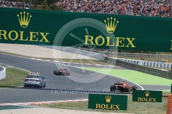 World © Octane Photographic Ltd. Formula 1 - Spanish Grand Prix Race. Max Verstappen - Red Bull Racing RB13 and Kimi Raikkonen with broken steering - Scuderia Ferrari SF70H limp back to the pits. Circuit de Barcelona - Catalunya, Spain. Sunday 14th May 2017. Digital Ref:1825LB1D4011