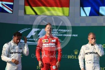 World © Octane Photographic Ltd. Formula 1 - Australian Grand Prix - Podium. Sebastian Vettel - Scuderia Ferrari SF70H, Lewis Hamilton and Valtteri Bottas - Mercedes AMG Petronas F1 W08 EQ Energy+. Albert Park Circuit. Sunday 26th March 2017. Digital Ref: 1803LB1D7381