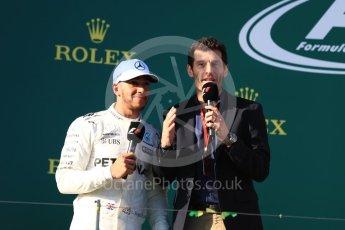 World © Octane Photographic Ltd. Formula 1 - Australian Grand Prix - Podium. Lewis Hamilton - Mercedes AMG Petronas F1 W08 EQ Energy+ and Mark Webber. Albert Park Circuit. Sunday 26th March 2017. Digital Ref: 1803LB1D7971