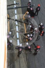 World © Octane Photographic Ltd. Formula 1 - Winter Test 2. Romain Grosjean - Haas F1 Team VF-17 and team doing a pit stop. Circuit de Barcelona-Catalunya. Friday 10th March 2017. Digital Ref: 1787LB5D0128