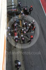 World © Octane Photographic Ltd. Formula 1 - Winter Test 2. Romain Grosjean - Haas F1 Team VF-17 and team doing a pit stop. Circuit de Barcelona-Catalunya. Friday 10th March 2017. Digital Ref: 1787LB5D0135