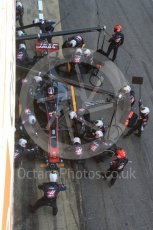 World © Octane Photographic Ltd. Formula 1 - Winter Test 2. Romain Grosjean - Haas F1 Team VF-17 and team doing a pit stop. Circuit de Barcelona-Catalunya. Friday 10th March 2017. Digital Ref: 1787LB5D0143