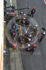 World © Octane Photographic Ltd. Formula 1 - Winter Test 2. Romain Grosjean - Haas F1 Team VF-17 and team doing a pit stop. Circuit de Barcelona-Catalunya. Friday 10th March 2017. Digital Ref: 1787LB5D0153