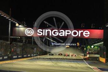 World © Octane Photographic Ltd. Formula 1 - Singapore Grand Prix - Race. The Scuderia Ferrari SF70Hs of Vettel and Raikkonen make contact. Marina Bay Street Circuit, Singapore. Sunday 17th September 2017. Digital Ref: