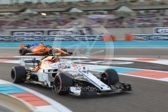 World © Octane Photographic Ltd. Formula 1 –  Abu Dhabi GP - Qualifying. Alfa Romeo Sauber F1 Team C37 – Charles Leclerc and McLaren MCL33 – Fernando Alonso. Yas Marina Circuit, Abu Dhabi. Saturday 24th November 2018.