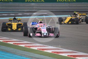 World © Octane Photographic Ltd. Formula 1 –  Abu Dhabi GP - Race. Racing Point Force India VJM11 - Esteban Ocon and Renault Sport F1 Team RS18 – Nico Hulkenberg and Carlos Sainz. Yas Marina Circuit, Abu Dhabi. Sunday 25th November 2018.