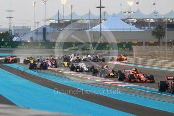 World © Octane Photographic Ltd. Formula 1 –  Abu Dhabi GP - Race. McLaren MCL33 – Fernando Alonso and Haas F1 Team VF-18 – Romain Grosjean run wide on the first corner. Yas Marina Circuit, Abu Dhabi. Sunday 25th November 2018.