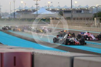 World © Octane Photographic Ltd. Formula 1 –  Abu Dhabi GP - Race. McLaren MCL33 – Fernando Alonso and Haas F1 Team VF-18 – Romain Grosjean and Kevin Magnussen run wide on the first corner. Yas Marina Circuit, Abu Dhabi. Sunday 25th November 2018.