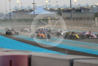 World © Octane Photographic Ltd. Formula 1 –  Abu Dhabi GP - Race. McLaren MCL33 – Fernando Alonso and Haas F1 Team VF-18 – Kevin Magnussen run wide on the first corner. Yas Marina Circuit, Abu Dhabi. Sunday 25th November 2018.