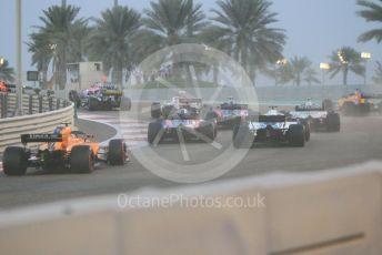 World © Octane Photographic Ltd. Formula 1 –  Abu Dhabi GP - Race. The pack head into T3 on the first lap. Yas Marina Circuit, Abu Dhabi. Sunday 25th November 2018.
