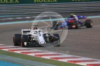 World © Octane Photographic Ltd. Formula 1 –  Abu Dhabi GP - Race. Alfa Romeo Sauber F1 Team C37 – Marcus Ericsson and Scuderia Toro Rosso STR13 – Pierre Gasly. Yas Marina Circuit, Abu Dhabi. Sunday 25th November 2018.