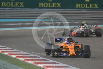 World © Octane Photographic Ltd. Formula 1 –  Abu Dhabi GP - Race. McLaren MCL33 – Fernando Alonso and Haas F1 Team VF-18 – Kevin Magnussen. Yas Marina Circuit, Abu Dhabi. Sunday 25th November 2018.