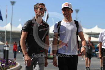 World © Octane Photographic Ltd. Formula 1 – Abu Dhabi GP - Paddock. Alfa Romeo Sauber F1 Team C37 – Charles Leclerc and Haas F1 Team VF-18 – Romain Grosjean. Yas Marina Circuit, Abu Dhabi. Friday 23rd November 2018.