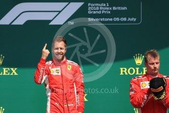 World © Octane Photographic Ltd. Formula 1 – British GP - Podium. Scuderia Ferrari SF71-H – Sebastian Vettel and Kimi Raikkonen. Silverstone Circuit, Towcester, UK. Sunday 8th July 2018.