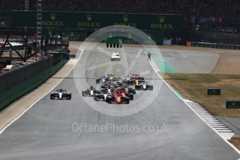 World © Octane Photographic Ltd. Formula 1 – British GP - Race. Race start Vettel's Ferrari leads Hamilton's Mercedes. Silverstone Circuit, Towcester, UK. Sunday 8th July 2018.