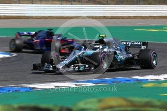 World © Octane Photographic Ltd. Formula 1 – German GP - Practice 1. Mercedes AMG Petronas Motorsport AMG F1 W09 EQ Power+ - Valtteri Bottas and Scuderia Toro Rosso STR13 – Brendon Hartley. Hockenheimring, Baden-Wurttemberg, Germany. Friday 20th July 2018.