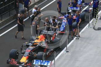 World © Octane Photographic Ltd. Formula 1 – Hungarian GP - Pit Lane. Aston Martin Red Bull Racing TAG Heuer RB14 – Daniel Ricciardo and Scuderia Toro Rosso STR13 – Brendon Hartley. Hungaroring, Budapest, Hungary. Thursday 26th July 2018.