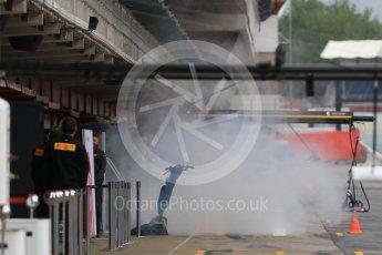 World © Octane Photographic Ltd. Formula 1 – In season test 1, day 2. Haas F1 Team VF-18 garage smoking after engine start. Circuit de Barcelona-Catalunya, Spain. Wednesday 16th May 2018.
