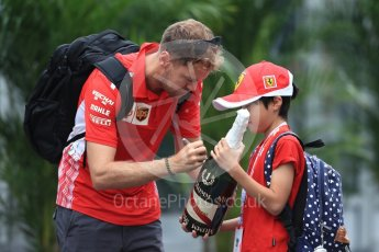 World © Octane Photographic Ltd. Formula 1 – Japanese GP - Paddock. Scuderia Ferrari SF71-H – Sebastian Vettel and young fan. Suzuka Circuit, Japan. Friday 5th October 2018.