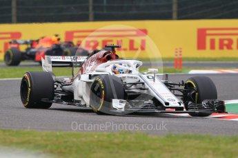 World © Octane Photographic Ltd. Formula 1 – Japanese GP - Practice 1. Alfa Romeo Sauber F1 Team C37 – Marcus Ericsson and Aston Martin Red Bull Racing TAG Heuer RB14 – Daniel Ricciardo. Suzuka Circuit, Japan. Friday 5th October 2018.