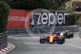 World © Octane Photographic Ltd. Formula 1 – Monaco GP - Practice 2. McLaren MCL33 – Stoffel Vandoorne and Haas F1 Team VF-18 – Kevin Magnussen. Monte-Carlo. Thursday 24th May 2018.