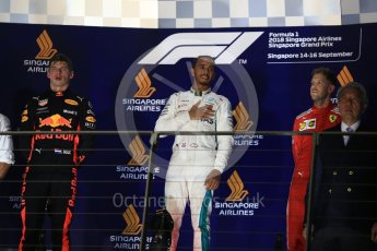 World © Octane Photographic Ltd. Formula 1 – Singapore GP – Race Podium. Mercedes AMG Petronas Motorsport AMG F1 W09 EQ Power+ - Lewis Hamilton, Aston Martin Red Bull Racing TAG Heuer RB14 – Max Verstappen and Scuderia Ferrari SF71-H – Sebastian Vettel. Marina Bay Street Circuit, Singapore. Sunday 16th September 2018.